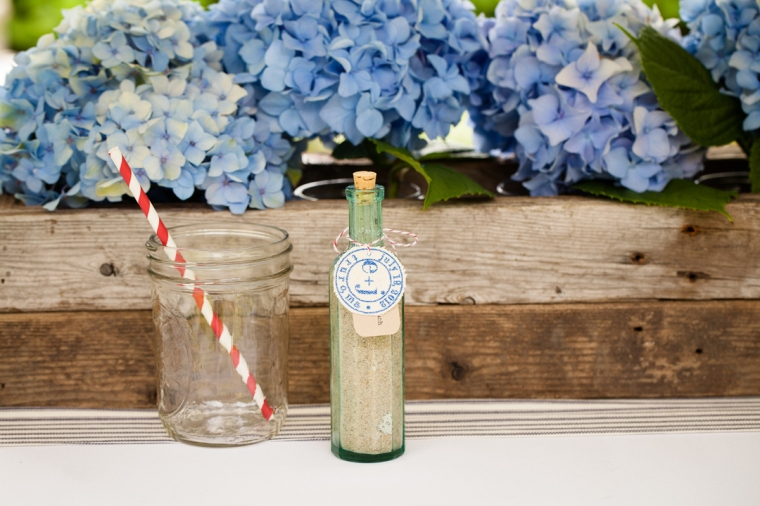 Vintage Glass Bottle Favors with custom labels by Hundred Acre.